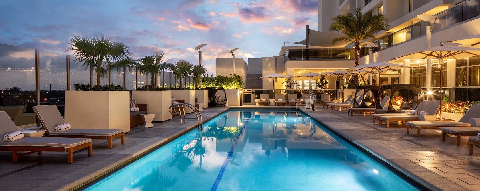 Pool at the Hilton Aventura Miami at sunset